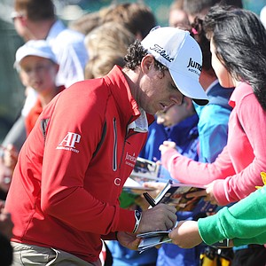 Rory McIlroy signs autographs for fans during the third practice round prior to the start of the 141st Open Championship at Royal Lytham & St. Annes.