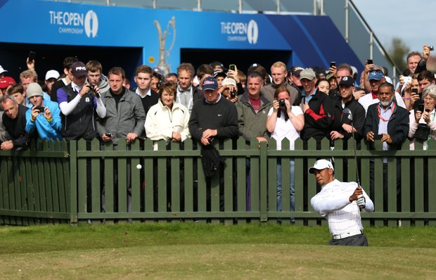 Tiger Woods plays a bunker shot on the practice ground as fans look on during the third practice round prior to the start of the 141st Open Championship at Royal Lytham & St. Annes.