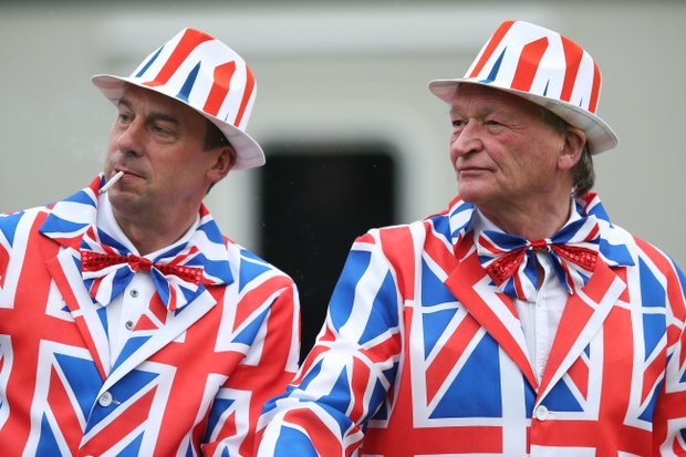 Golf fans watch the play on the first hole during the first round of the 141st Open Championship at Royal Lytham & St Annes Golf Club.