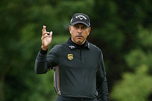 Jeev Milkha Singh acknowledges the crowd on the second hole during the first round of the 141st Open Championship at Royal Lytham & St. Annes Golf Club.
