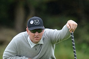 David Duval lines up a putt during the first round of the 141st Open Championship at Royal Lytham & St. Annes Golf Club.