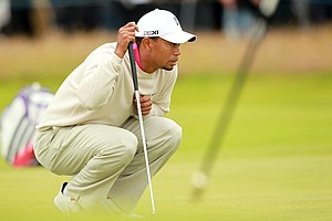 Tiger Woods lines up his putt on the 2nd green during his first round of the 2012 Open Championship at Royal Lytham & St. Annes.