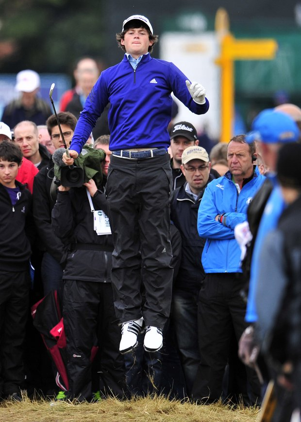 Amateur golfer Alan Dunbar jumps to get a better view on the 2nd hole during his first round at the 2012 Open Championship at Royal Lytham & St. Annes.