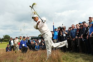 Tiger Woods plays a shot from the rough on the 15th hole during the first round of the 141st Open Championship at Royal Lytham & St. Annes Golf Club.