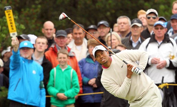 Tiger Woods watches his shot from the 7th tee during his first round of the 2012 Open Championship at Royal Lytham & St. Annes.