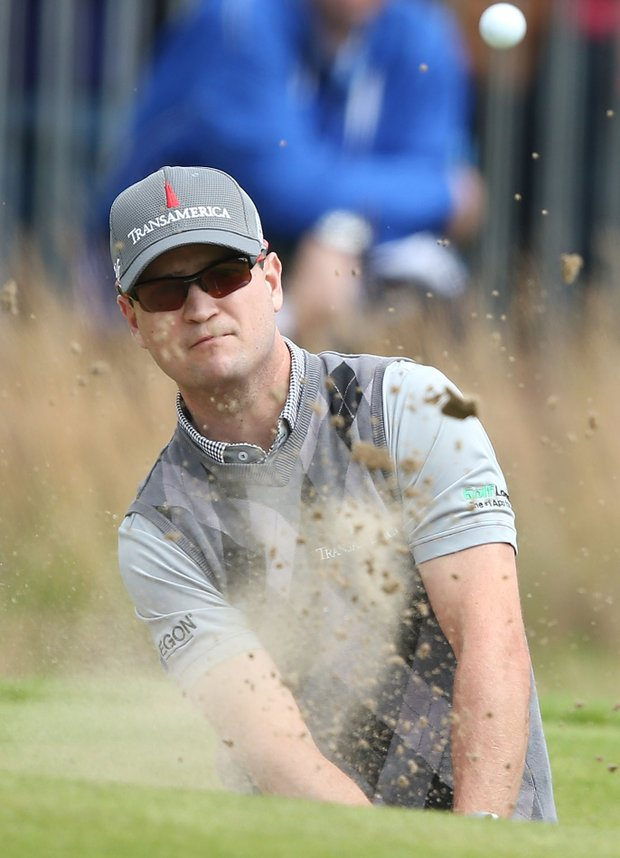 Zach Johnson plays out of a bunker on the 18th hole during the first round of the 141st Open Championship at Royal Lytham & St. Annes Golf Club.