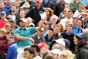 Sergio Garcia drops his club as he watches his shot from the 14th tee during his first round of the 2012 Open Championship at Royal Lytham and St. Annes.