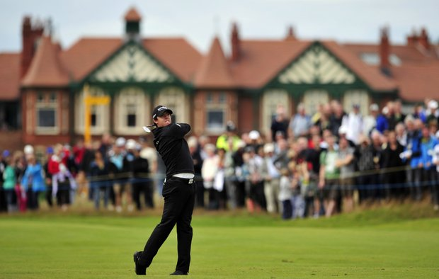 Rory McIlroy watches his shot from the 2nd fairway during his first round at the 2012 Open Championship at Royal Lytham and St. Annes.