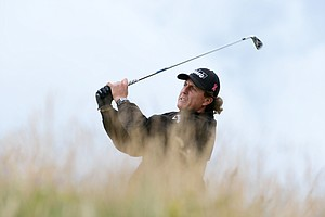 Phil Mickelson hits his tee shot on the 11th hole during the first round of the 141st Open Championship at Royal Lytham & St. Annes Golf Club.