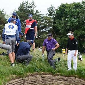 Phil Mickelson searches for his golf ball on the 8th hole during the first round of the 141st Open Championship at Royal Lytham & St. Annes Golf Club.