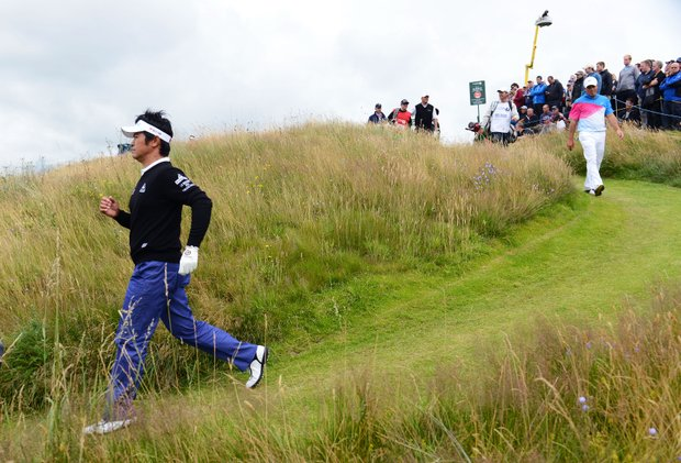 Toshinori Muto walks down the 11th hole during the first round of the 141st Open Championship at Royal Lytham & St. Annes Golf Club.