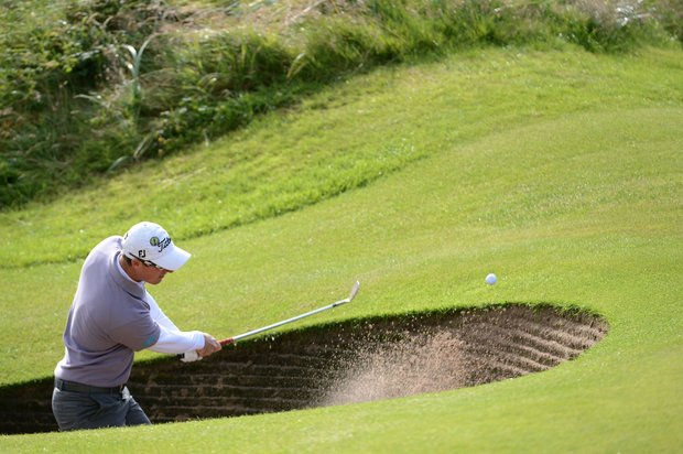 Nicolas Colsaerts plays a bunker shot on the third hole during the second round of the 141st Open Championship at Royal Lytham & St. Annes Golf Club.