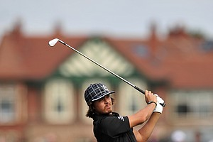 Rickie Fowler watches his iron shot from the second fairway during his second round at the 2012 Open Championship at Royal Lytham and St. Annes.