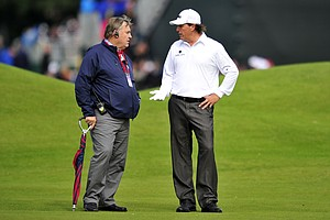 Phil Mickelson talks to a rules official on the second fairway during his second round at the 2012 Open Championship at Royal Lytham and St. Annes.