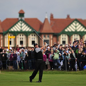 Bo Van Pelt watches his iron shot from the second fairway with the clubhouse seen behind during his second round at the 2012 Open Championship at Royal Lytham and St. Annes.