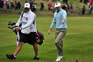 Brandt Snedeker points to the pheasant walking on the course during his second round at the 2012 Open Championship at Royal Lytham and St. Annes.