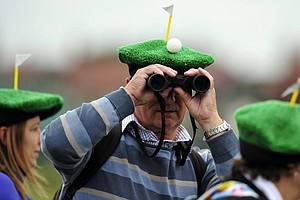 Spectators wearing comical hats watch the play on Day 2 of the 2012 Open Championship at Royal Lytham and St. Annes.