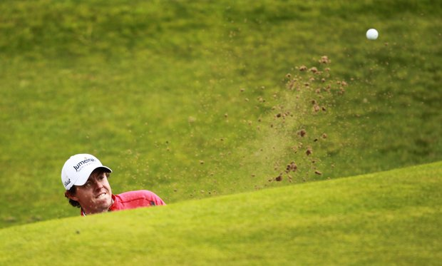 Rory McIlroy plays out of a bunker on the 6th hole during his second round of the 2012 Open Championship at Royal Lytham and St. Annes.