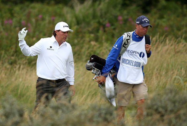 Phil Mickelson and his caddie Jim Mackay walk along the 13th hole during the second round of the 141st Open Championship at Royal Lytham & St. Annes Golf Club.