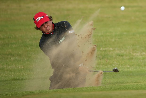 Jason Dufner plays a bunker shot on the 11th hole during the second round of the 141st Open Championship at Royal Lytham & St. Annes Golf Club.