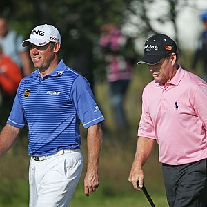 Lee Westwood, left, and Tom Watson walk together on the third hole during the third round of the 141st Open Championship at Royal Lytham & St. Annes Golf Club.