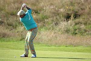 John Daly hits his approach shot on the fourth hole during the third round of the 141st Open Championship at Royal Lytham & St. Annes Golf Club.