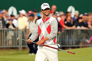 Adam Scott smiles as he walks onto the 18th green during the third round of the 2012 Open Championship at Royal Lytham and St. Annes.
