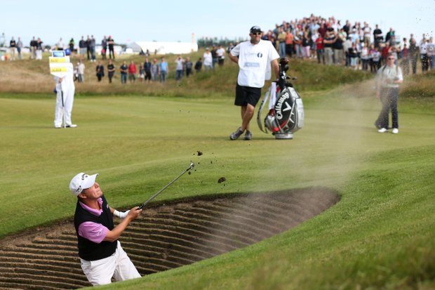 Fredrik Jacobson plays a bunker shot during the final round of the 141st Open Championship at Royal Lytham & St. Annes Golf Club.