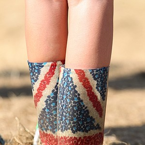 Union flag boots worn by a young lady litter collector are seen during the final round of the 2012 Open Championship at Royal Lytham and St. Annes.