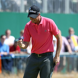 Nicolas Colsaerts celebrates a par-saving putt on the 18th green for a 5-under 65 during the final round of the 141st Open Championship at Royal Lytham & St. Annes Golf Club.