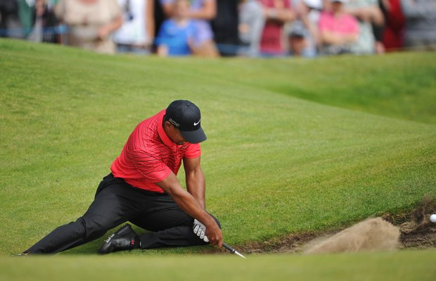Tiger Woods watches a bunker shot on the sixth hole during the final round of the 141st Open Championship at Royal Lytham & St. Annes Golf Club.