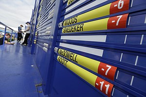 A scoreboard at Royal Lytham & St. Annes Golf Club shows the scores on the final round at the Open Championship.