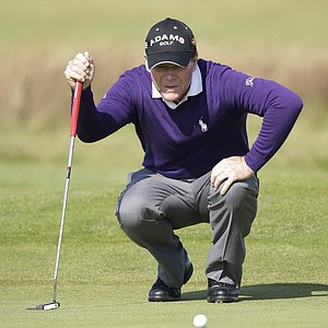 Tom Watson lines up a putt on the 17th green at Royal Lytham & St. Annes Golf Club during the final round at the Open Championship.