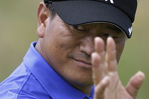 KJ Choi reacts after putting on the 14th green at Royal Lytham & St. Annes Golf Club during the final round at the Open Championship.