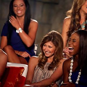 Zakiya Randall, far right, bursts into laughter with Christina Stockton while filming the Big Break Atlantis Reunion show at the Latin Quarter.