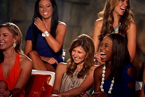 Zakiya Randall, far right, bursts into laughter with Christina Stockton while filming the Big Break Atlantis Reunion show at the Latin Quarter.