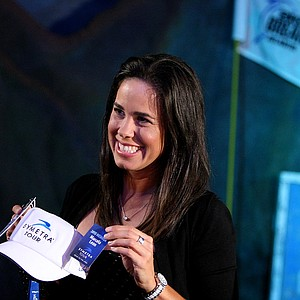 Marcela Leon poses for pictures after being presented with her Symetra Tour card on Tuesday during the filming of the Big Break Reunion show.