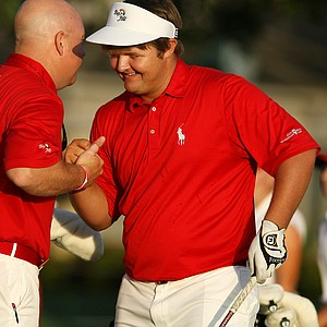 East team Cody Proveaux, right, with team captain Mark Oskarson prior to the start of the 2012 Wyndham Cup at Bay Hill Club and Lodge in Orlando, Fla.