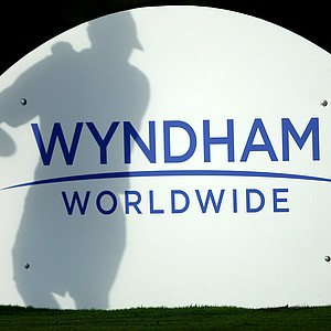 A shadow of one of the players is evident as the sun rises for the 2012 Wyndham Cup at Bay Hill Club and Lodge.