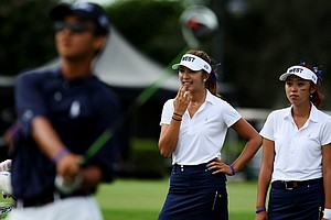 Alison Lee, left, and Esther Lee. right, watch as the group before them tees off at the 2012 Wyndham Cup. After the morning matches, East was leading West 6.5 to 3.5.