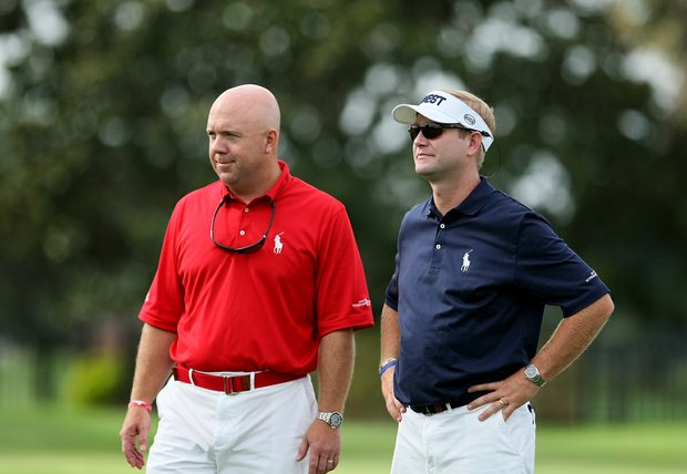 East team captain Mark Oskarson, left, and West team captain Jason Miller, right, watch as players tee off at the 2012 Wyndham Cup.