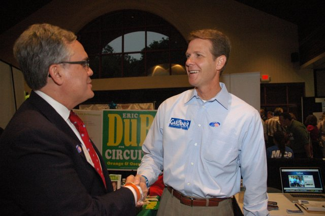 Winter Park Mayor Ken Bradley shakes hands with Florida Sen. Andy Gardiner at the Winter Park Chamber of Commerce's Political Mingle July 23.