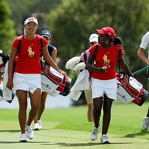 Annie Park, left, and Mariah Stackhouse, right, of East team walk up to No. 13 on Wednesday during the morning foursome matches. They halved their match against Lindsey Weaver and Esther Lee.