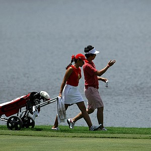 James Yoon and his caddie Nicole Morales of the East team at hole No. 3 on Wednesday during the afternoon mixed four-ball matches.