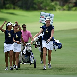 The West team's Hee Wook Choi, Amy Lee and Jessica Vasilic make their way up No. 5 on Wednesday during the afternoon mixed four-ball matches.