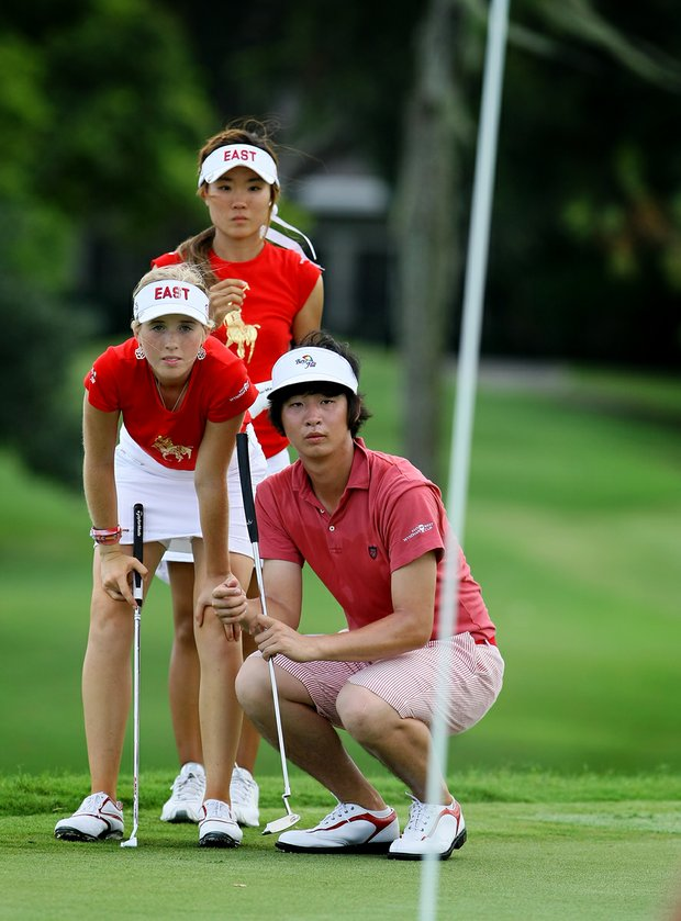 The East team's James Yoon, right, Casey Danielson, middle and Karen Chung, top, look over their putt at No. 5 on Wednesday during the afternoon mixed four-ball matches.