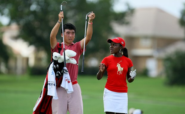 The East's Doug Ghim caddied for Mariah Stackhouse on Wednesday during the afternoon mixed four-ball matches.