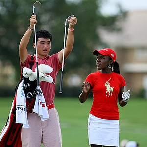 The East's Doug Ghim caddied for Mariah Stackhouse on Wednesday during the afternoon mixed four-ball matches at the 2012 Wyndham Cup.