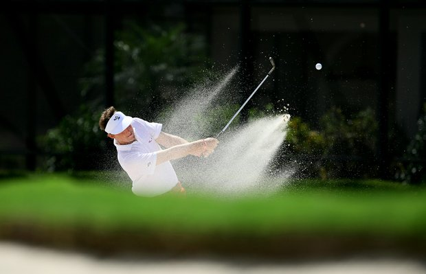 Matthew NeSmith hits a shot from the bunker at No. 15 during Thursday's single matches at the 2012 Wyndham Cup.