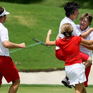 The East's Cody Proveaux is mobbed by his teammates after he won his single match against Brad Dalke allowing the East to retain the 2012 Wyndham Cup.